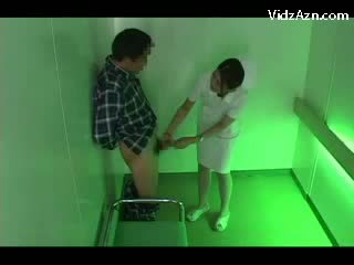 Nurse On Her Knees Giving Blowjob For Patient Cum To Palm In The Elevator