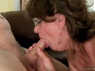 Grandma sucking and riding young cock