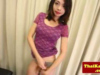 Stripteasing Ladyboy Stroking Her Dick