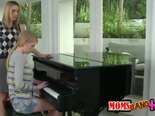 Bossy piano teacher MILF spanks teen a...