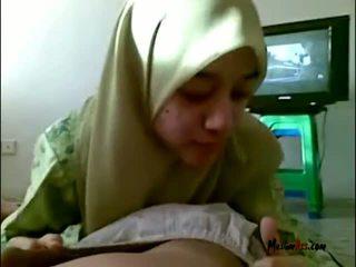 Hijab tonårs sugande bollar