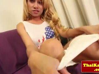 Longhaired asian ladyboy masturbating