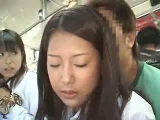 Two schoolgirls groped in a bis