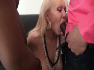 Mature in stockings fucked by 2 blacks...