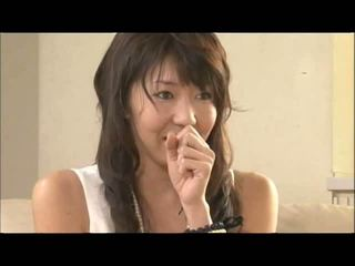Two masseurs play with a pair of big jepang susu