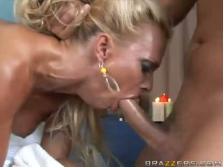 Busty oiled blonde sucking huge cock and gets her pussy pounded