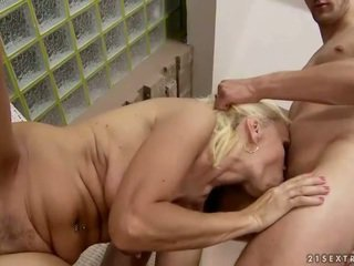 Hot granny enjoys sex with younger man