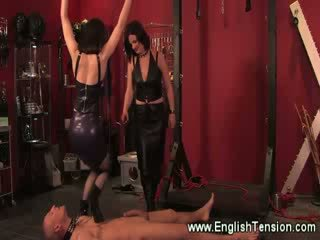 Dominas trample and spank their collared sub