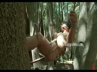 Big gay guy hanged from trees in ropes naked outdoor and fucked in his wide opened ass
