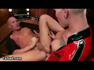 Bigtit Blond Tranny in latex fucks guy on the table