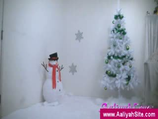 Aaliyah next to the Xmas tree
