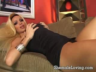 Super sexy blonde shemale with an amazing tits takes it deep down