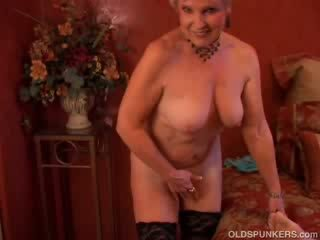 Pretty cougar sucks boner and eats cum