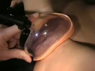 Skinny brunette uses pussy pump and fingers herself