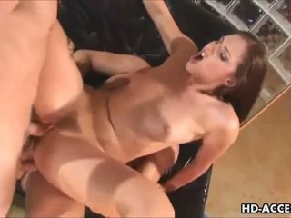 Sexy brunette takes on two cocks and takes one