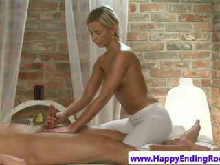 Massage model tugging on client cock and loves it