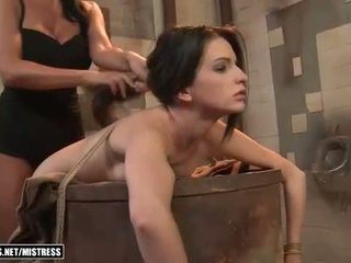 Mistress dominates young slave girl