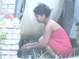 Indian Village Girl Bathing Outdoors