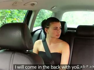 Brunette girl fucking in fake taxi outdoors