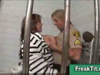 Busty female prisoner sucks cop
