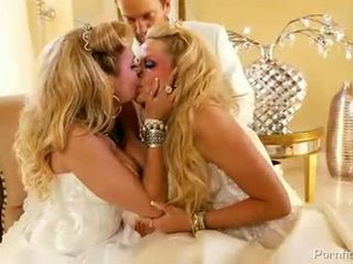 Two blondies with huge baloons in bridal dresses sharing one cock