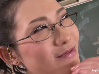 Horny Japanese Teacher Fucks Herself in a Classroom.
