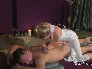Blonde masseuse fucks guy on a inflatable mattress