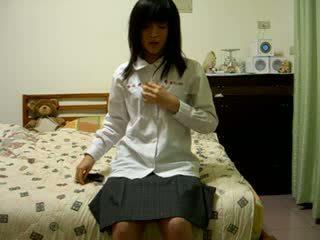 שיערי סיני נערה ב מצלמת וידאו