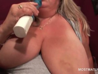 Blonde mature with giant tits dildo fucks herself