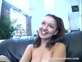 Check out this brunette as she loves posing for the camera during her interview.