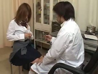 Horny doctor fingering hairy pussy