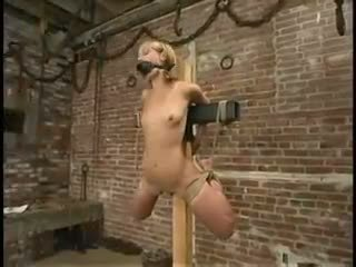 Blonde slave strung up with ropewhippedgaggedand vibra