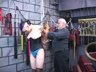 BDSM goth chick gets bound, spanked and nipples pinched by two men in chamber