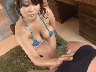 Busty asian in blue bikini blows a cock