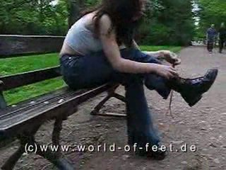 Girl taking off her boots and licking her feet