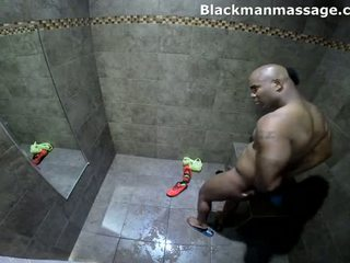 Sexy black man takes shower at gym
