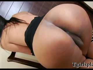Shemale strips and masturbates her dick